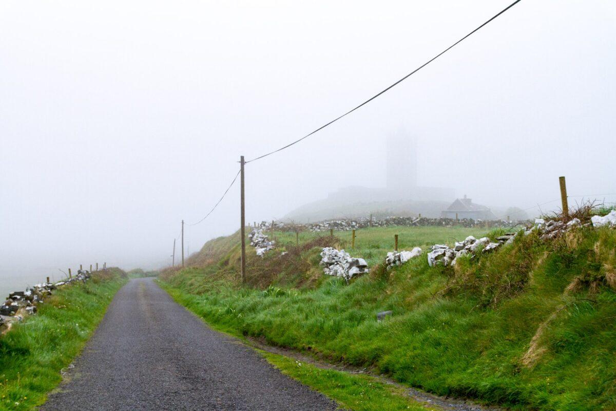 Rural road on a misty day. Photo by Dimitry Anikin on Unsplash